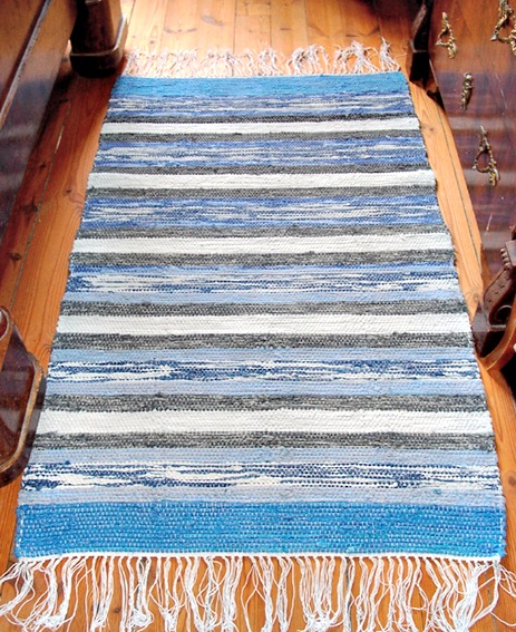 Blue and white rectangular rag rug.