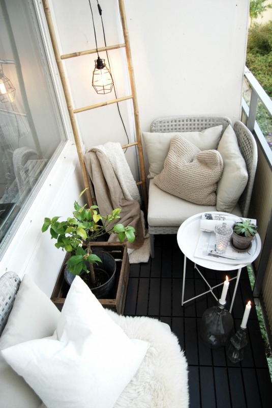 White balcony with a black floor.