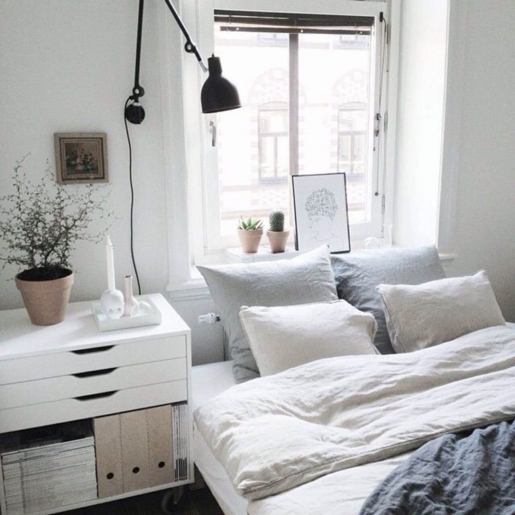 Unbleached linen lends that casually chic touch to a modern Scandinavian bedroom.