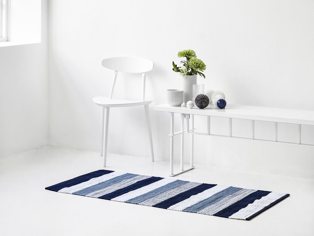 Striped rag rug by Rug Solid of Denmark. It's made from (new) cotton remnants collected from clothing manufacturers around the world. They have a wide range of solids, several mixed color ones (traditional trasmatta style) and a few striped ones.