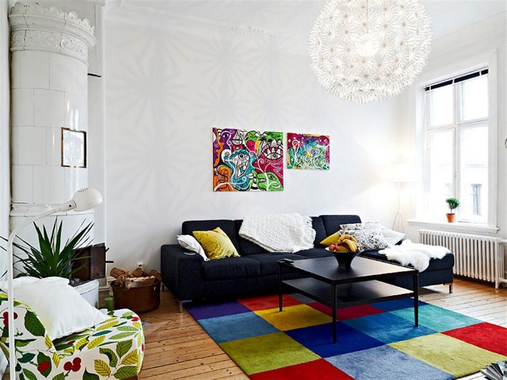 Well-placed splashes of tropical color add some verve to a white Swedish interior. The simple geometric patter lets the colors shine without looking gaudy.