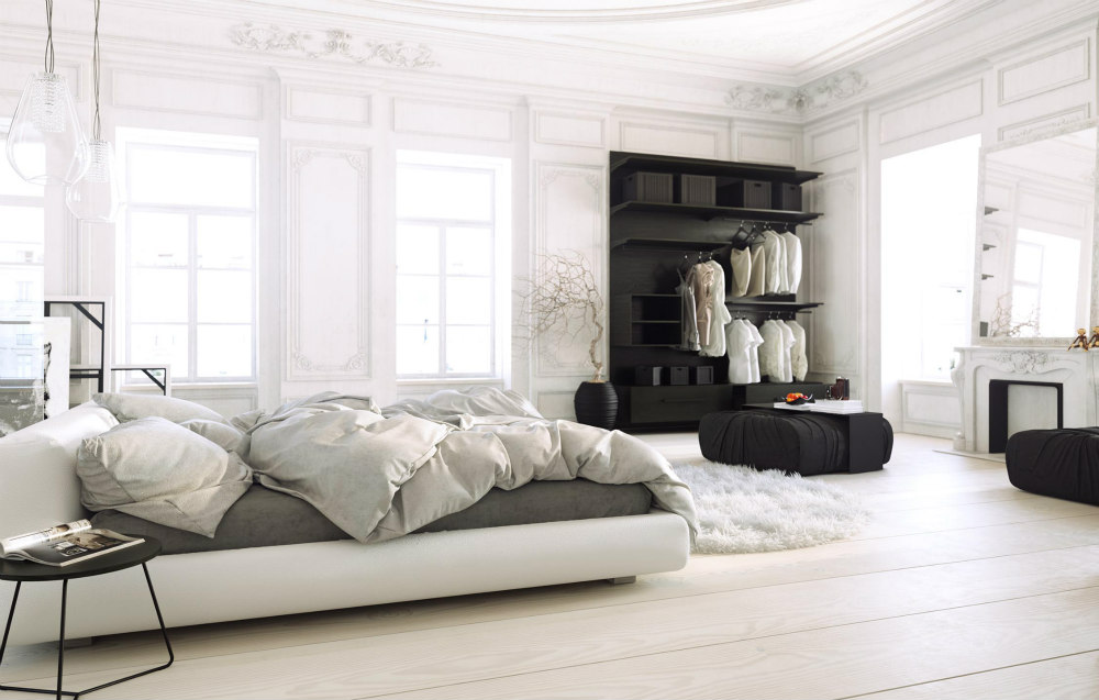 A spacious black and white bedroom that makes good use of texture.
