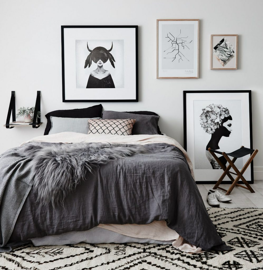 Grey and pink soften a monochrome Scandinavian bedroom.
